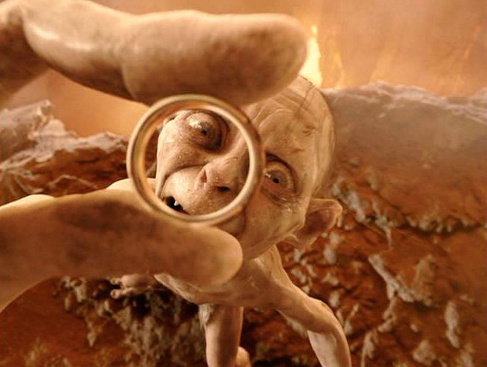 Gollum holding the One Ring